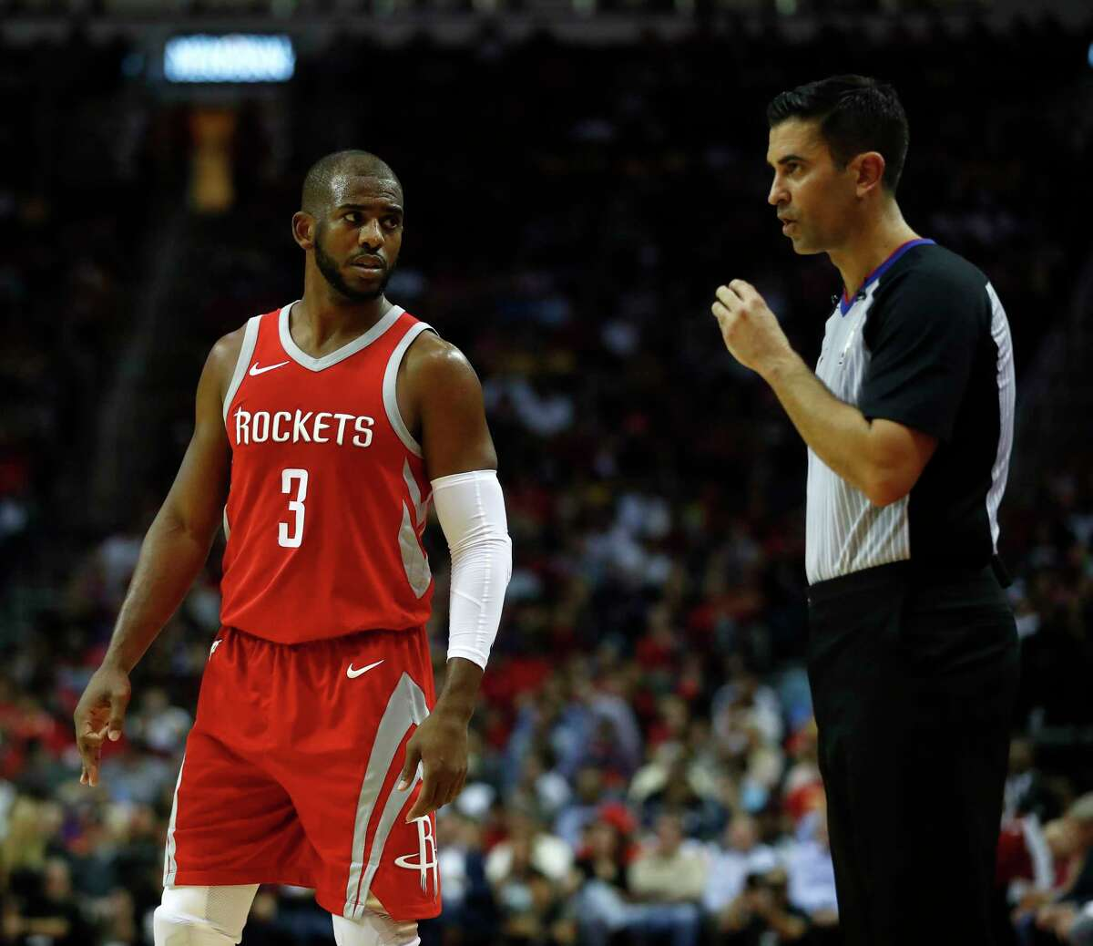 Houston Rockets guard Chris Paul (3) talks with referee Zach Zarba during the second half of an NBA basketball game at Toyota Center, Wednesday, Dec. 20, 2017, in Houston.