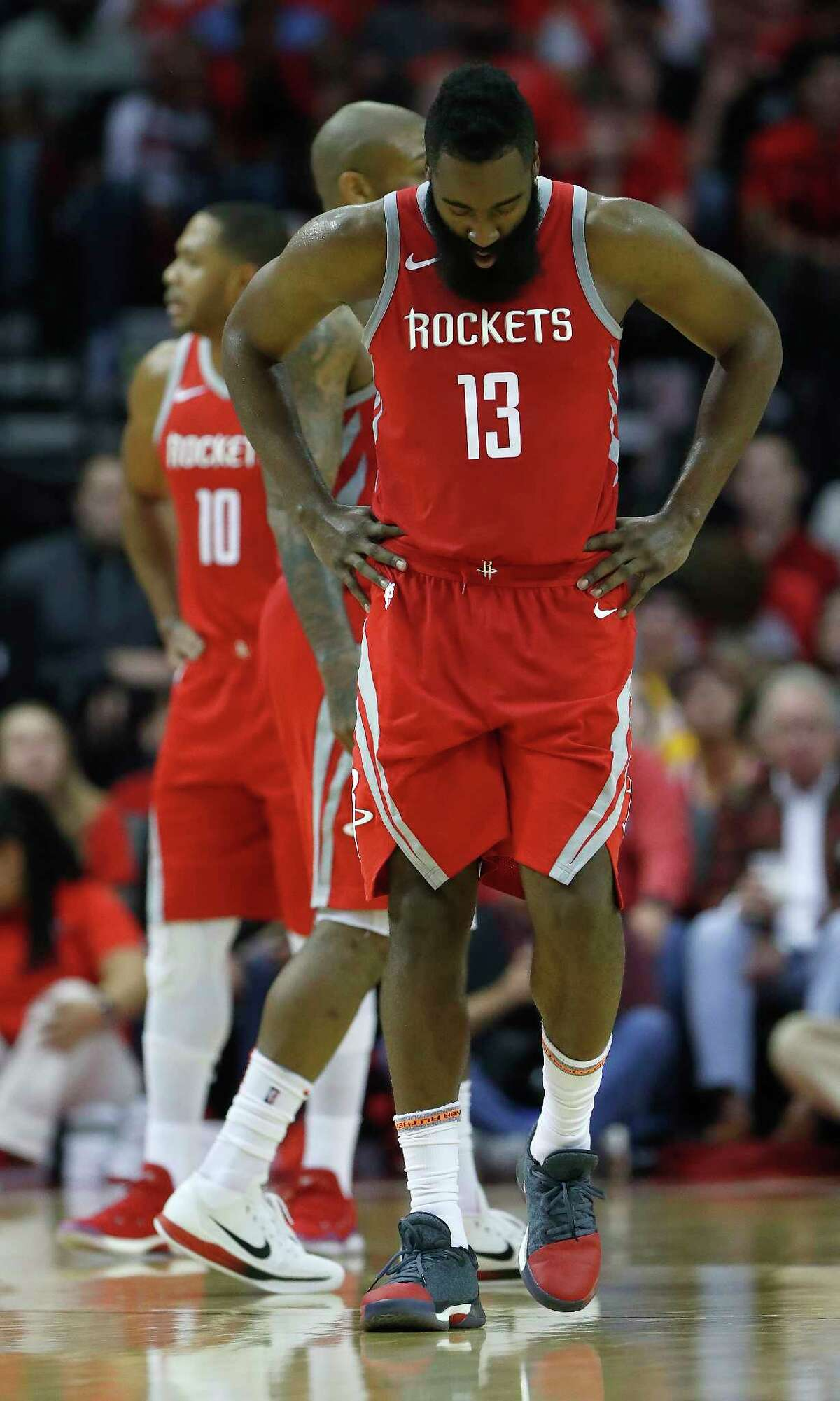 Houston Rockets guard James Harden (13) reacts after getting hit in the chest during the second half of an NBA basketball game at Toyota Center, Wednesday, Dec. 20, 2017, in Houston.