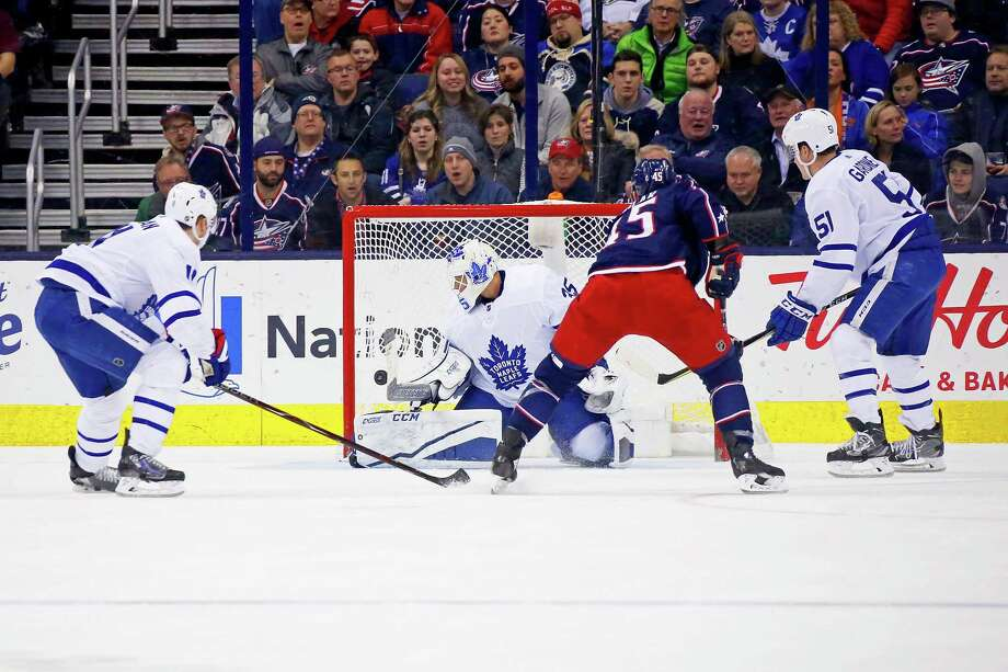 COLUMBUS, OH - DECEMBER 20:  Lukas Sedlak #45 of the Columbus Blue Jackets flips the puck past Curtis McElhinney #35 of the Toronto Maple Leafs for a goal during the first period of the game on December 20, 2017 at Nationwide Arena in Columbus, Ohio. (Photo by Kirk Irwin/Getty Images) Photo: Kirk Irwin / 2017 Getty Images