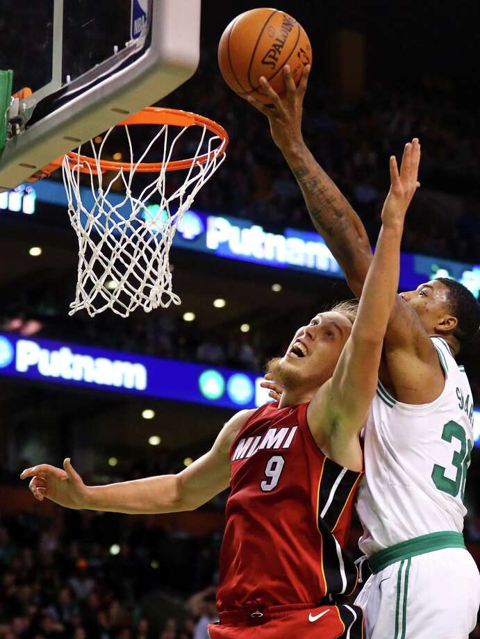 BOSTON, MA - DECEMBER 20: Marcus Smart #36 of the Boston Celtics grabs a rebound over Kelly Olynyk #9 of the Miami Heat during the second half at TD Garden on December 20, 2017 in Boston, Massachusetts. The Heat defeat the Celtics 90-89. (Photo by Maddie Meyer/Getty Images) Photo: Maddie Meyer / 2017 Getty Images