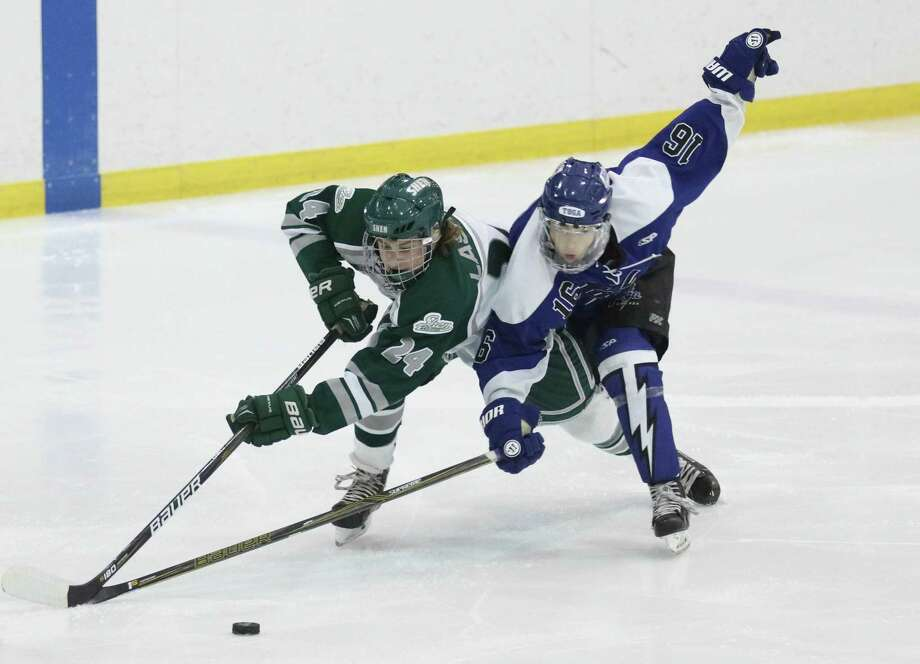 Shen's Chris Lasher battles for the puck with Saratoga's Rob Maslak during their high school hockey matchup at Prestige Services Arena in Clifton Park Wednesday, December 20, 2017. (Ed Burke photo - Special to The Times Union)