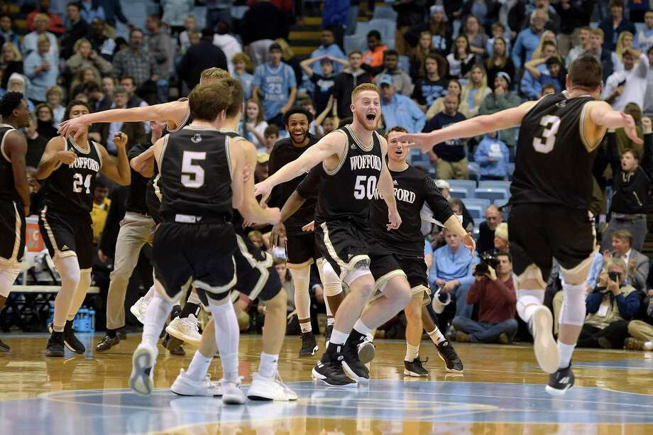 CHAPEL HILL, NC - DECEMBER 20: Matthew Pegram #50 and Fletcher Magee #3 of the Wofford Terriers celebrate with teammates following their win against the North Carolina Tar Heels at Dean Smith Center on December 20, 2017 in Chapel Hill, North Carolina. Wofford won 79-75. (Photo by Lance King/Getty Images) Photo: Lance King / 2017 Getty Images