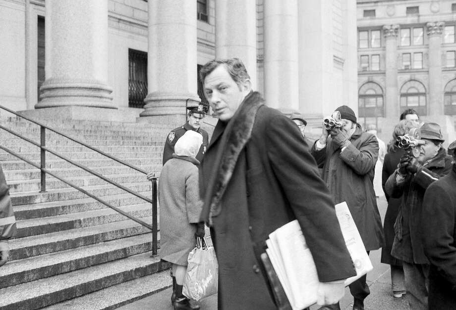 File - In this March 13, 1972 file photo, author Clifford Irving is seen as he enters federal court in New York. Irving, the prankster who wrote a phony autobiography of billionaire Howard Hughes and fooled a major publisher in 1971 has died at 87. The New York Times reports Irving's wife, Julie Irving, confirmed that he died Tuesday, Dec, 19, 2017, at a hospice near his Sarasota home. (AP Photo/Jim Wells, File) Photo: Jim Wells, Associated Press