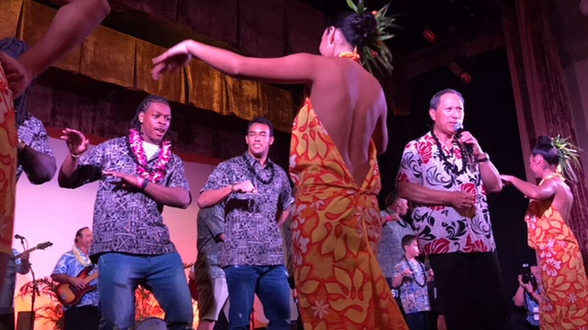 University of Houston players Garrett Davis, left, and Trevon Bradley participate in a hula demonstration during Wednesday night's Hawaii Bowl luau. Houston will face Fresno State in the Hawaii Bowl Sunday night.