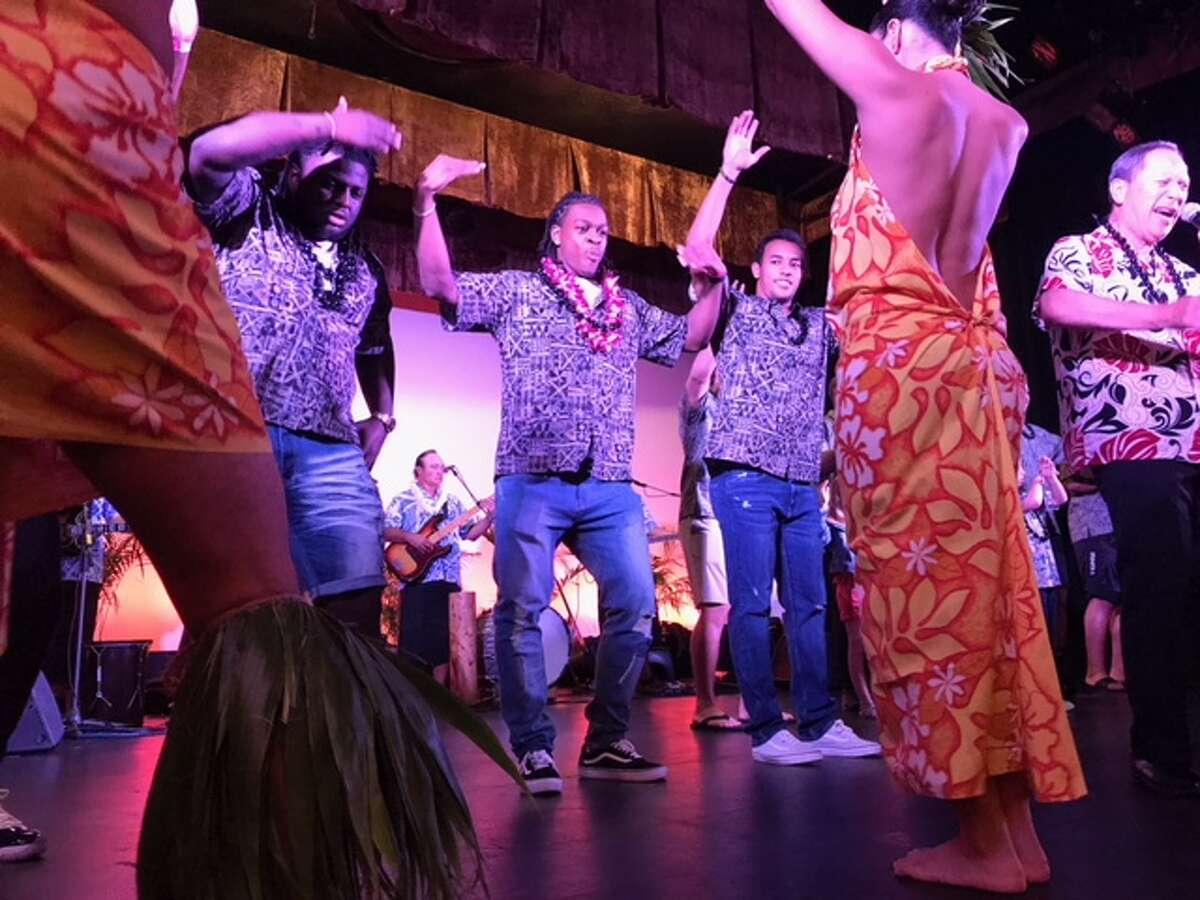 University of Houston players participate in a hula demonstration during Wednesday night's Hawaii Bowl luau. Houston will face Fresno State in the Hawaii Bowl Sunday night.