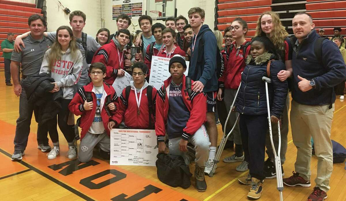 The Greens Farms Academy wrestling team poses for a photo after winning the Shelton Invitational wrestling meet on Saturday in Shelton. The team includes wrestlers from throughout many Fairfield County towns.