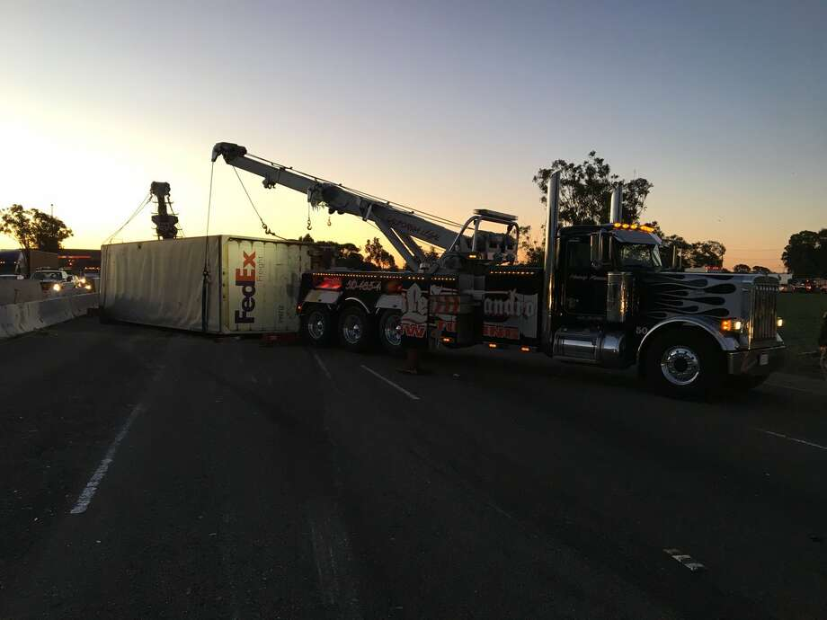 caltrans works to remove a fedex truck involved in an accident early thursday morning traffic