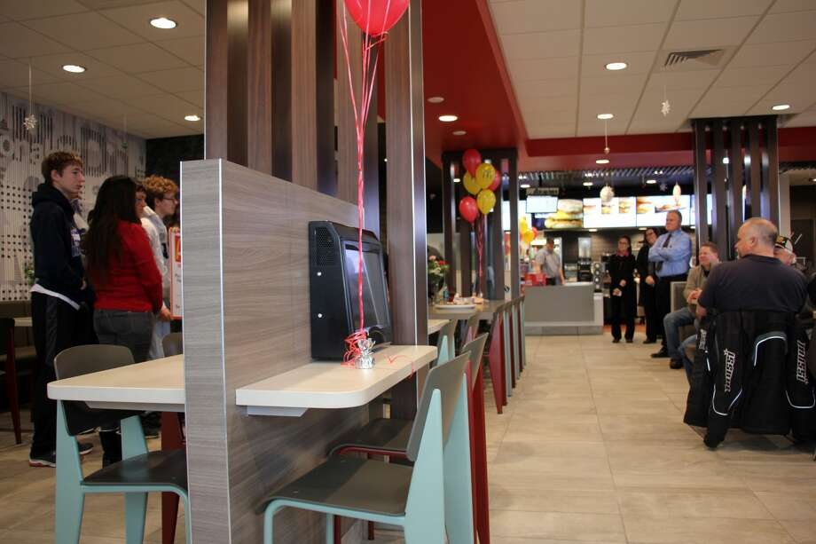 The Bad Axe McDonald's hosted its grand reopening Thursday morning. The restaurant was closed for a few months to remodel the building, which now features a kiosk system for customers to personally order their meals. Photo: Bradley Massman/Huron Daily Tribune