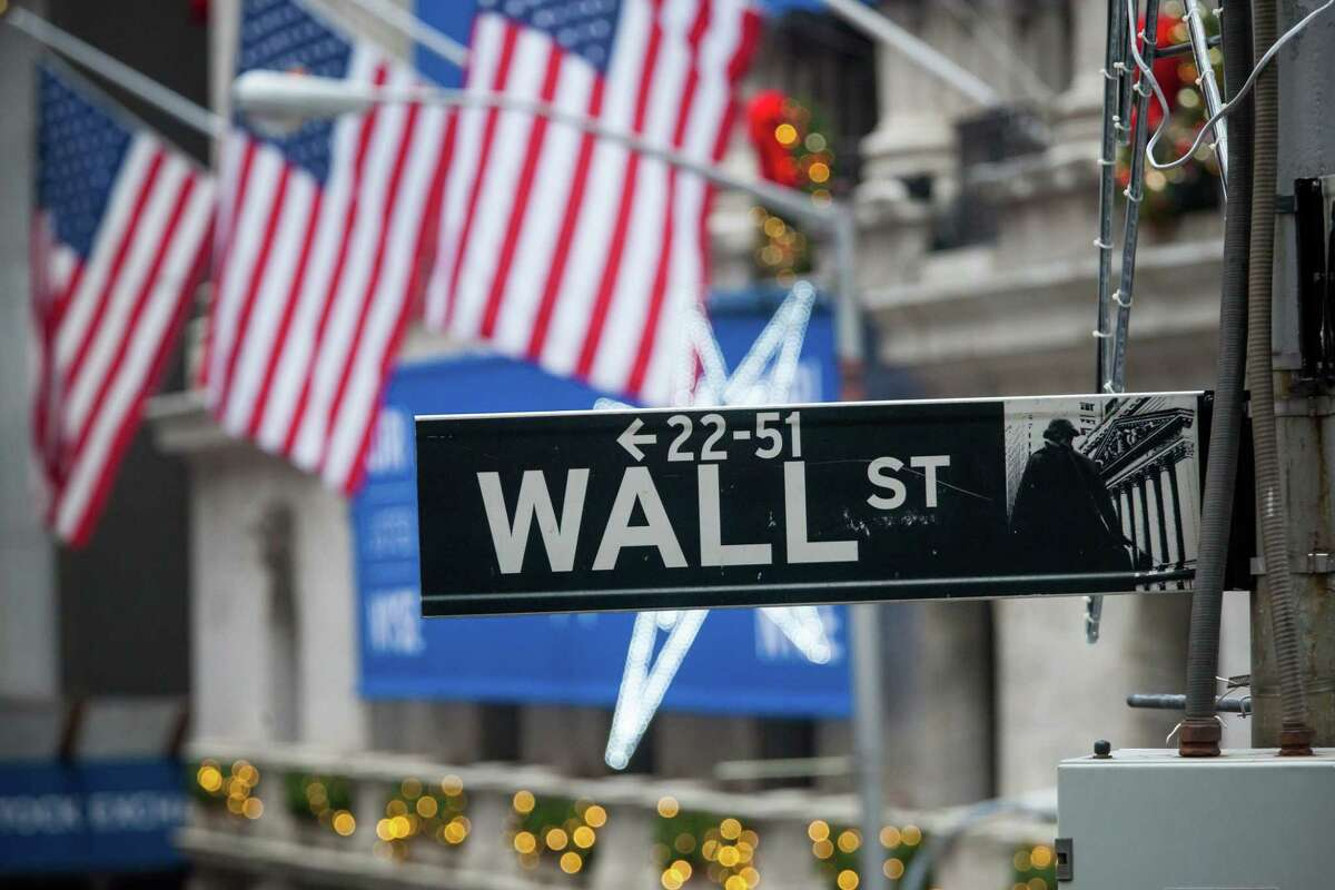 A Wall Street sign is seen in front of the New York Stock Exchange in New York on Dec. 18, 2017.