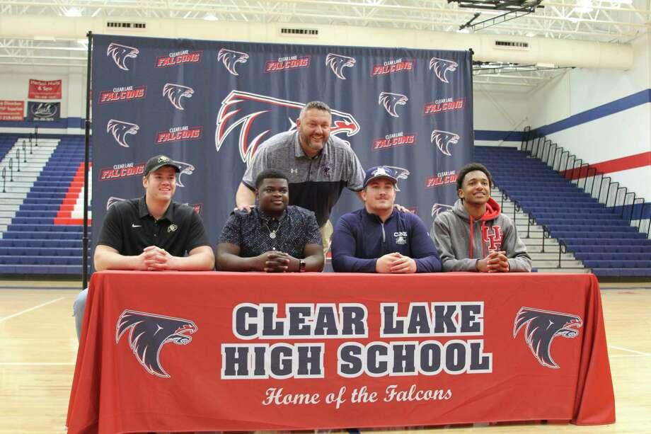 Clear Lake football players signing national letters of intent on Wednesday are (left to right) Frank Fillip (Colorado), Akin Magbagbeola (Navy), Brock Joyner (Concordia-Nebraska) and Ja'Kori Morgan (Houston) with Falcon head coach Larry McRae. Photo: Brandon Waggett