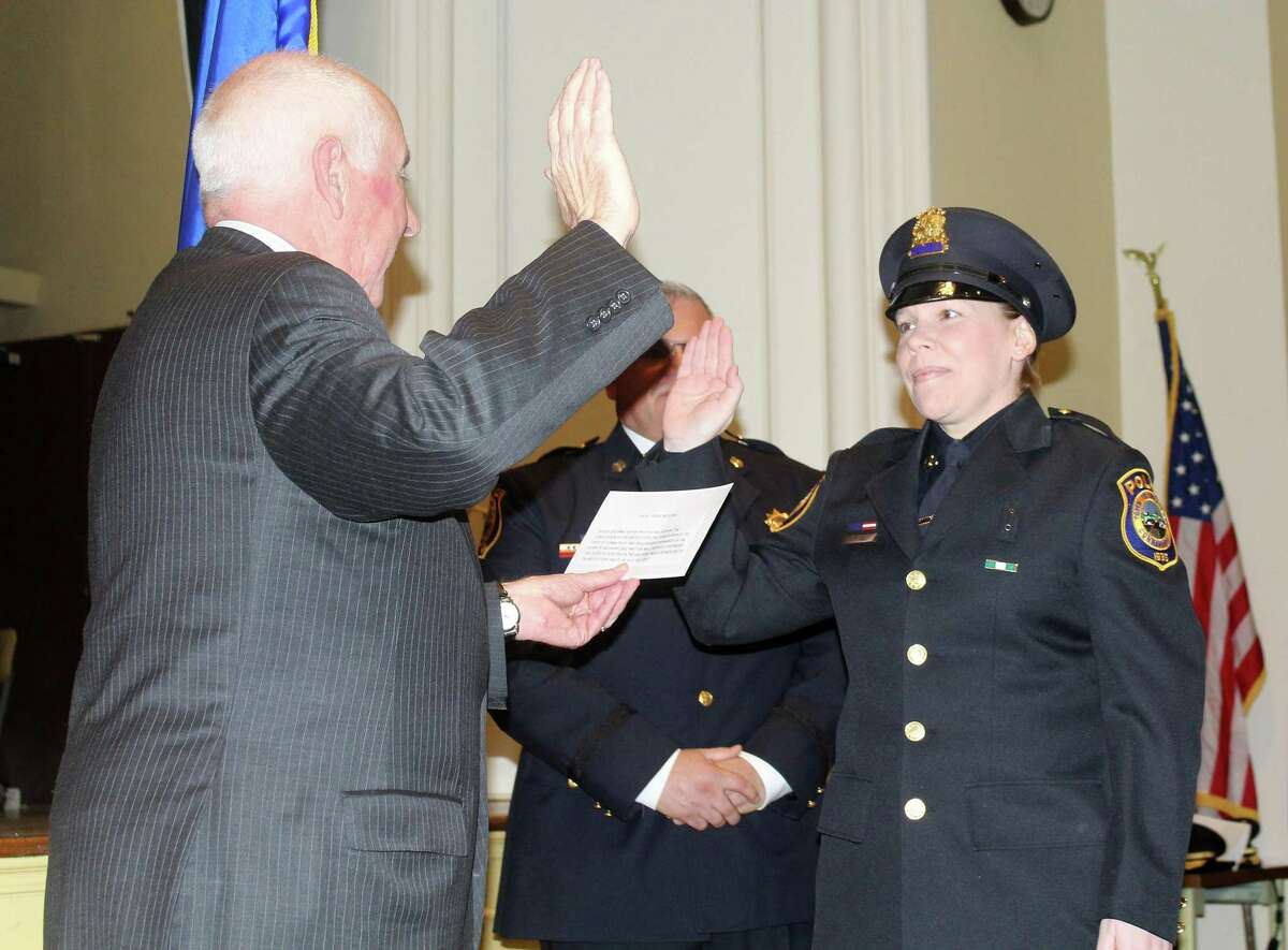 Officer Erin Shaw is promoted to detective at a ceremony at Westport Town Hall Dec. 14.