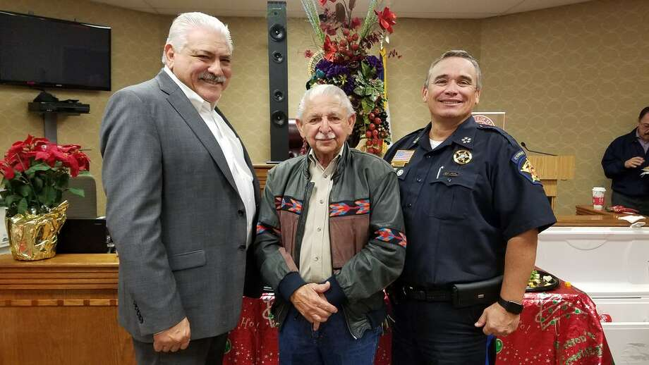 "Pct. 4 Justice of the Peace Jose ""Pepe"" Salinas, retired Justice of the Peace Oscar Martinez and Pct. 4 Constable Harold Devally pose for a photo during the annual tamalada held at Salinas' courtroom. Photo: Courtesy"