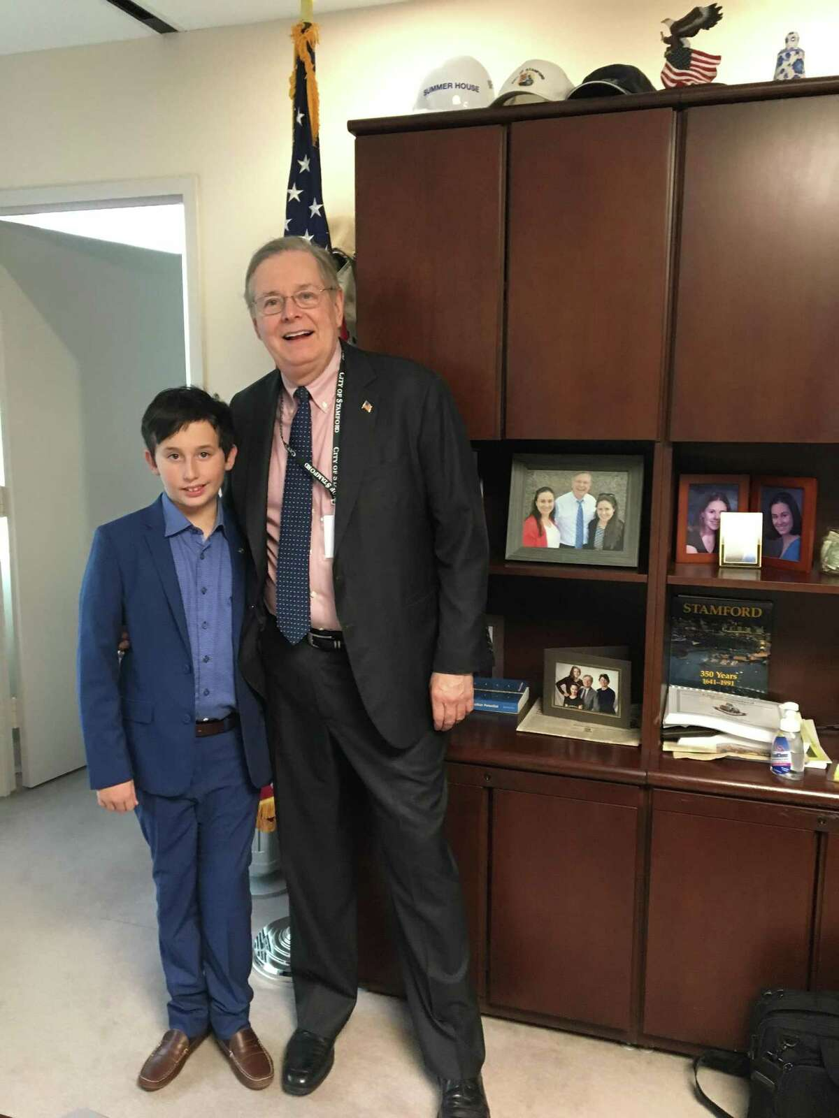"""Jordan Alexander and Stamford Mayor David Martin during the New Canaan boy's stint as """"Mayor for a Day."""""""