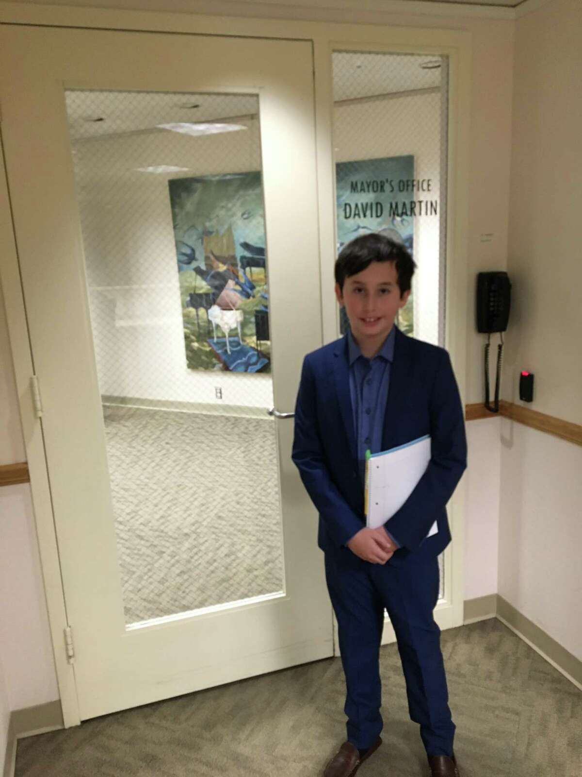 """Jordan Alexander takes a tour of the Stamford Government Center during his stint as """"Mayor for a Day."""""""