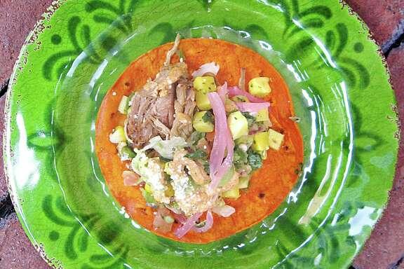 Mango carnitas taco on a corn tortilla from Barriba Cantina.
