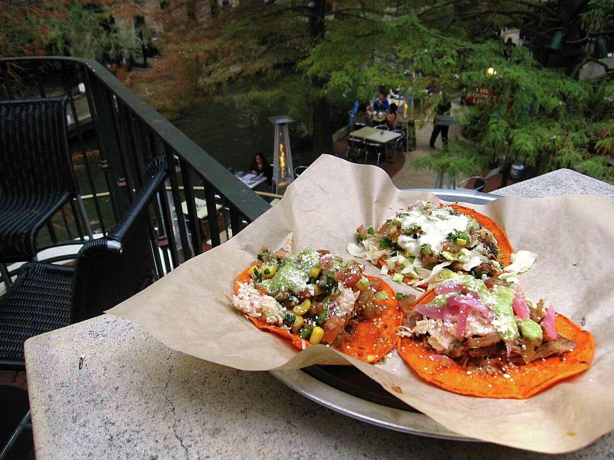 Del Rey beef taco, left, a Baja pescado taco and a chipotle carnitas taco from Barriba Cantina.