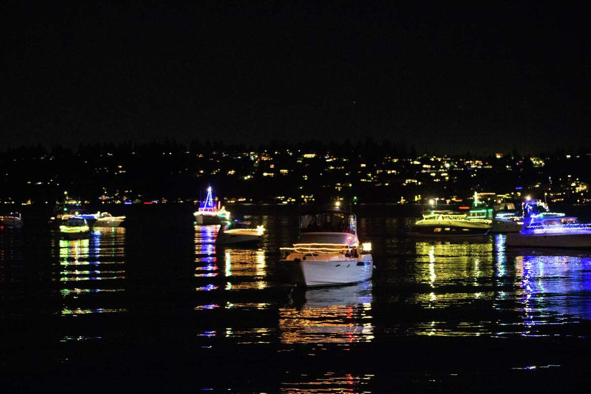 Private boats follow the Christmas Ship and her follow boats during a cruise around Lake Washington on Wednesday, Dec. 20, 2017.