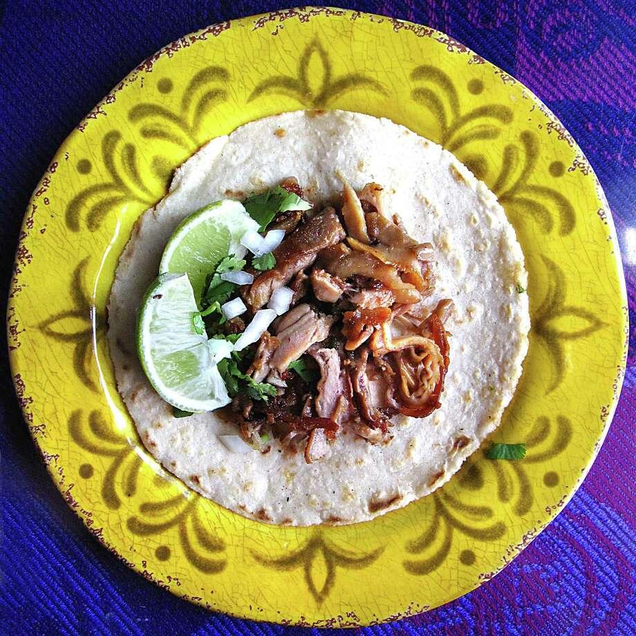 Morcon (pig cheek) taco on a handmade corn tortilla from Restaurante El D.F. Photo: Mike Sutter /San Antonio Express-News