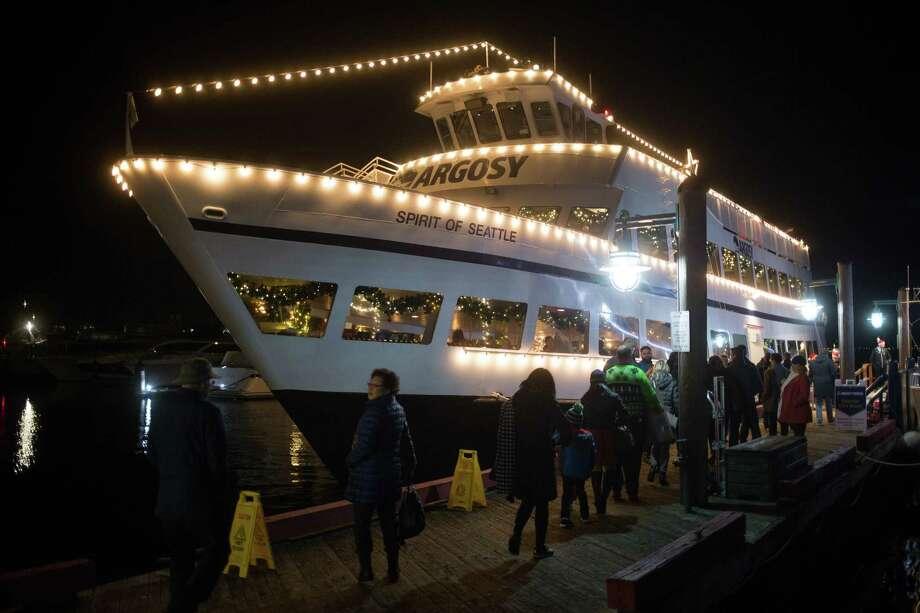The Argosy Christmas Ships are boarded at Kirkland City Dock for a Christmas cruise around Lake Washington on Wednesday, Dec. 20, 2017. Photo: GRANT HINDSLEY, SEATTLEPI.COM / SEATTLEPI.COM