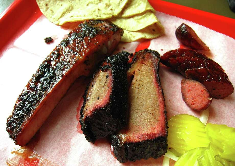 Pork rib, beef brisket and sausage from King's Hwy Brew & Q. Photo: Mike Sutter /San Antonio Express-News