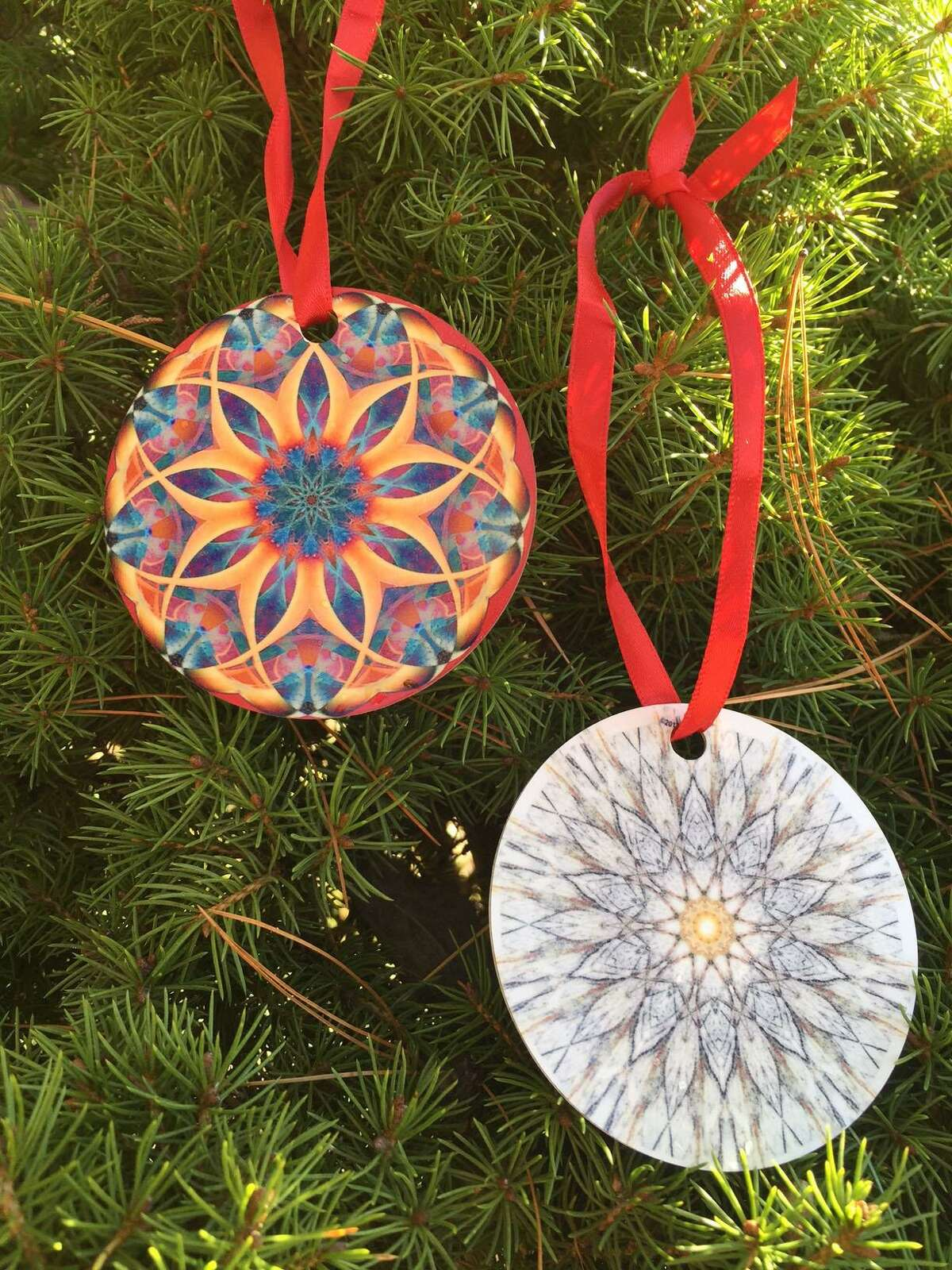 Sherman Library in Sherman Center is exhibiting a holiday show featuring photographs by Barbara Soares and Jim Stasiak through Jan. 25. Above are ornaments by the artists.