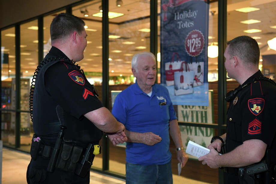 Corporal Daniel Lynch, left, and Sgt. Aaron Strain, right, from the Harris County Pct. 4 Constable's Office, visit with Bill James who was on his way to Barnes and Nobles in Champion Forest, during the officer's patrol to promote robbery prevention and personal safety on Dec. 20, 2017. (Photo by Jerry Baker/Freelance) Photo: Jerry Baker, Freelance / Freelance