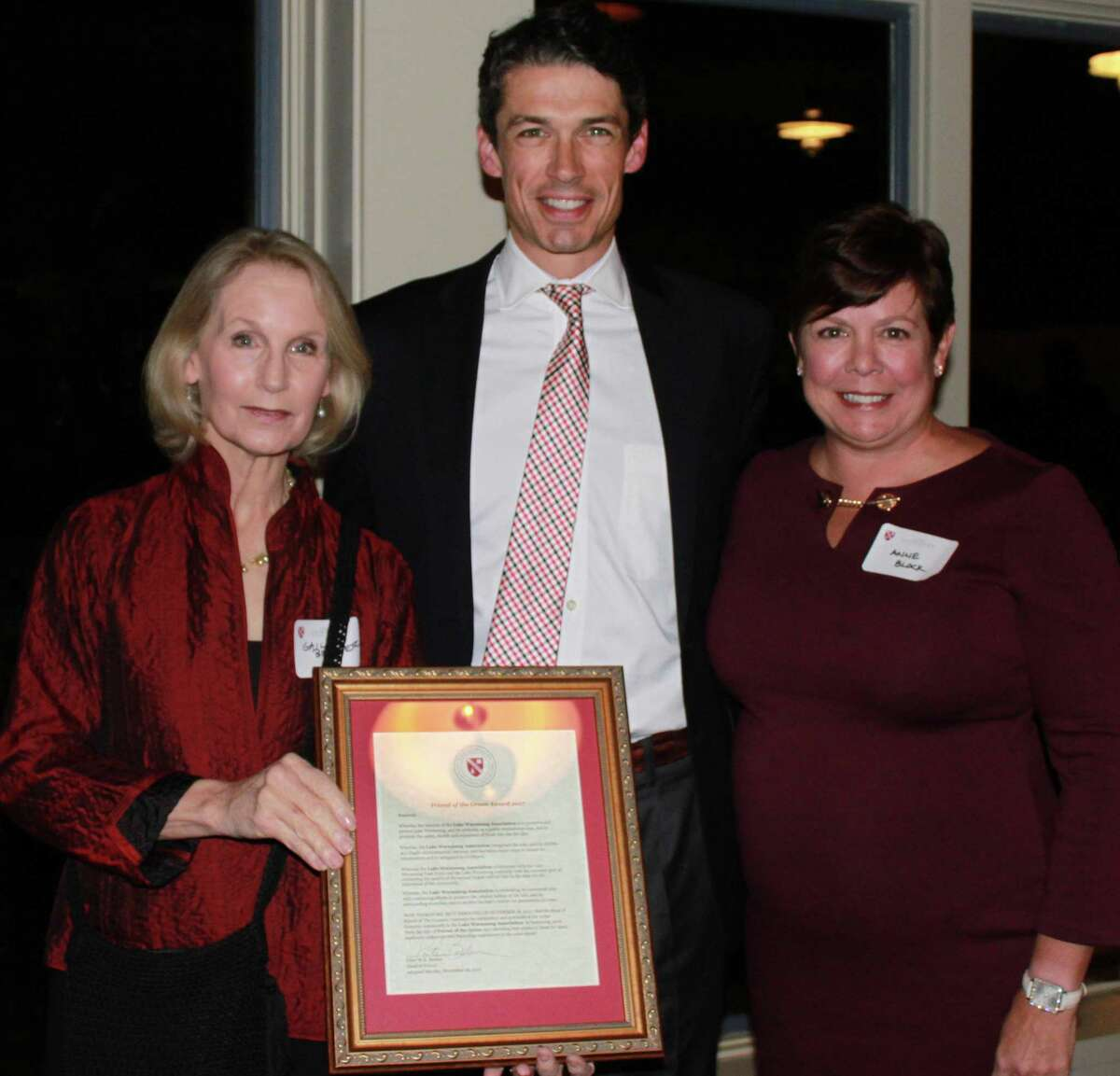 The Gunnery in Washington recently hosted a town party and presented its Friend of the Green Award to the Lake Warmarug Association. Peter Becker, head of school, center, presented the award to association co-presidents Gail Berner, left, and Anne Block.