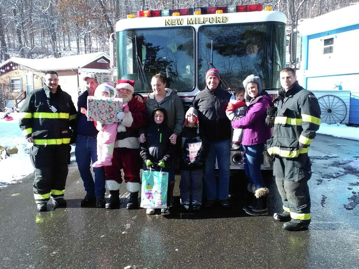 Water Witch Hose Company No. 2 held its annual Santa Express on Dec. 10 in New Milford. Two teams of firefighters, accompanied by Santa Claus, delivered presents to children at 40 different stops in town during the day. One of the stops was Eden Lane in Candle Hill Mobile Home Community. Above, from left, are firefigher Seth Castagna, Wes Morse, Johnna Morse, 2, Santa Claus, Michelle Svendberg, Liam Servoss, 6, Dave and Melissa McVeigh, Ryan McVeigh, 6, Colton McVeigh,18 months, and firefighter Ed Powers. Driving the truck is firefighter Jeff Emmons.