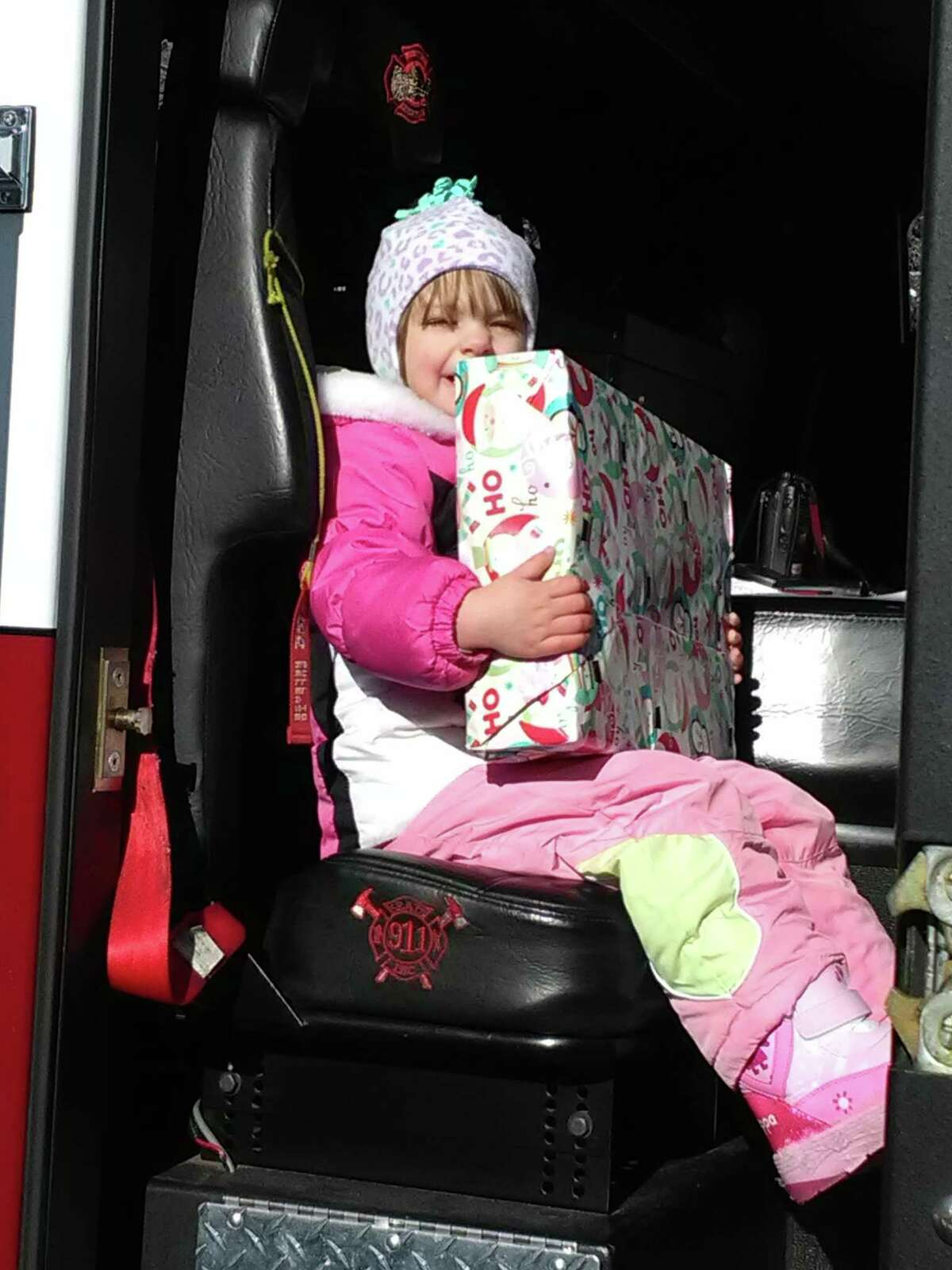 Santa Claus visited families on Eden Lane in New Milford on Sunday, Dec. 10 for Water Witch Hose Company No. 2's annual Santa Express. Each child received a gift from Santa and a chance to sit in the fire truck, including Johnna Morse, 2.