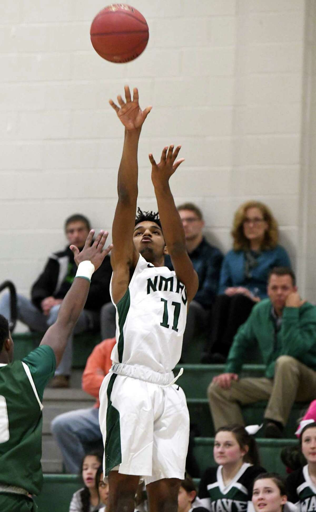 New Milford's Matthew Brevard makes a shot during the New Milford vs Norwalk boys basketball game at New Milford, Dec. 18, 2017.