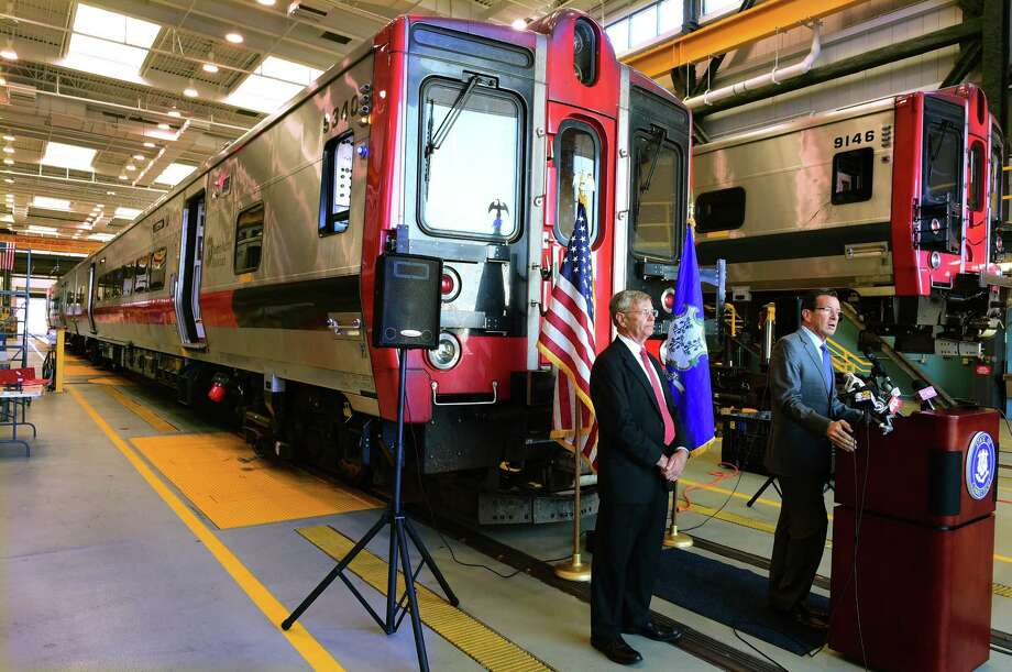 FILE PHOTO Governor Dannel P. Malloy, right, and Connecticut Department of Transportation Commissioner James P. Redeker announce the purchase of 60 M8 Rail Cars for the New Haven Line operated by Metro-North Railroad during a press conference Tuesday, September 13, 2016 at the New Haven Rail Yard on Brewery Street in New Haven. Of the 60 new rail cars, 10 will be bar cars. Photo: Peter Hvizdak / ©2016 Peter Hvizdak / ©2016 Peter Hvizdak