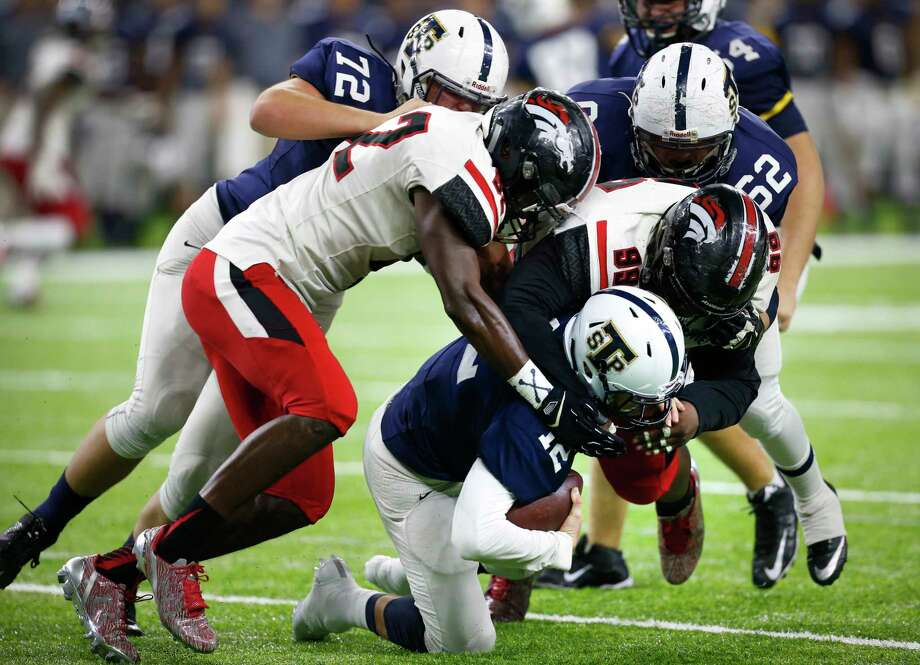 Westfield defensive tackle Keondre Coburn (99) sacks Round Rock Stony Point quarterback Jack Driskill. Coburn was named Defensive Player of the Year at the Touchdown Club of Houston's UIL awards dinner. Photo: Brett Coomer, Staff / © 2016 Houston Chronicle