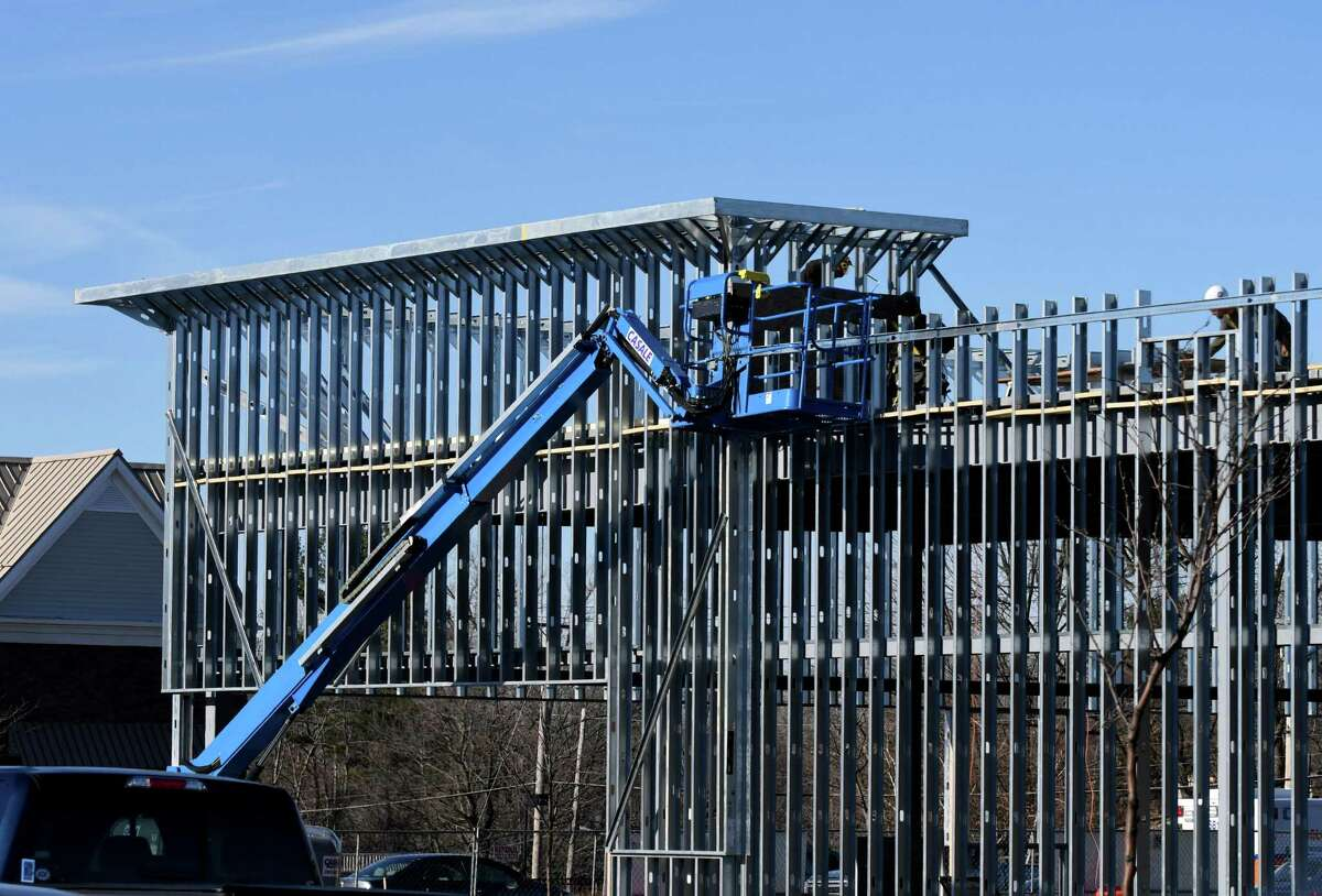 Construction of a new building in Fresh Market Commons takes place on Thursday, Dec. 21, 2017 in Colonie, N.Y.(Will Waldron/Times Union)