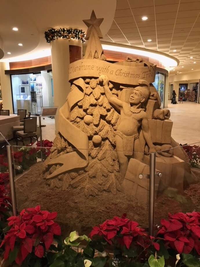 The Houston football team was greeted by an impressive display of sand sculptures depicting a unique spin on the 12 Days of Christmas at their hotel in Honolulu. The Cougars face Fresno State in the Hawaii Bowl on Sunday night. Photo: Joseph Duarte/Houston Chronicle