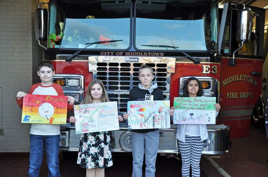 From left are fourth-graders Austin Carta and Addyson Gennaro and fifth-graders Austin Wood and Raima Maitra. Photo: Middletown Fire Department Photo