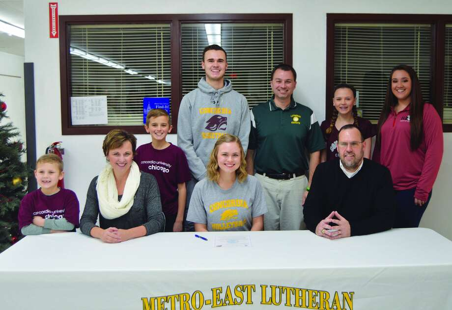 MELHS senior Emily Schwarz, seated center, will play volleyball for Concordia University Chicago. Others pictured from left to right are Joey Schwarz, brother, Beth Schwarz, mother, Jack Schwarz, brother, Justin Schwarz, brother, MELHS coach Jon Giordano, Jeff Schwarz, father, Katie Schwarz, sister, and club volleyball coach Emily Thebeau.