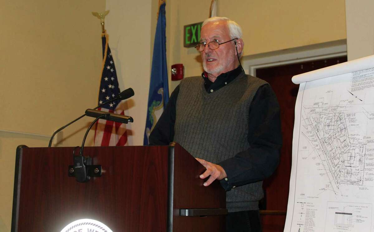 Mel Barr of Bar Associates spoke on behalf of a proposed development at 500 Main St. at a public hearing on the topic in Westport Town Hall on Dec. 14.