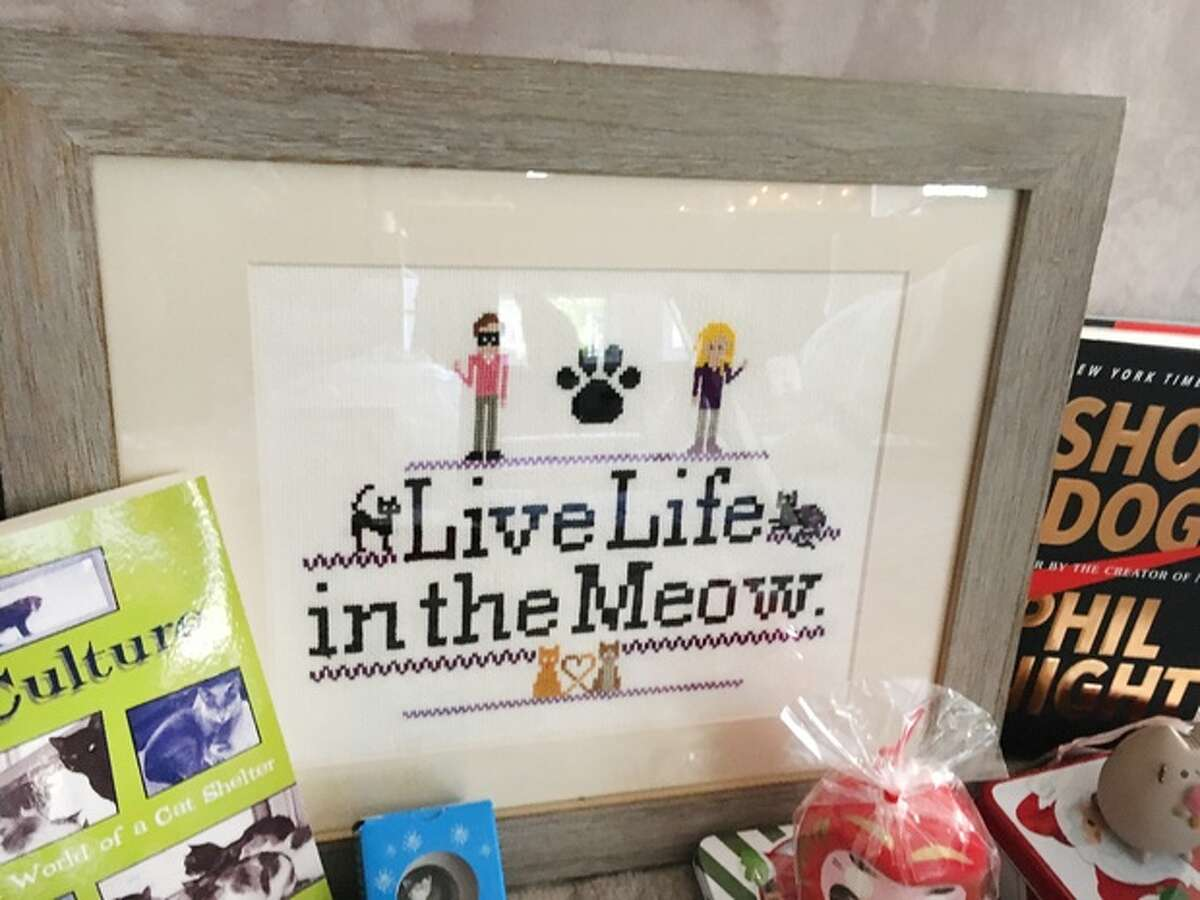 A custom cross stitch included in Megan Cummins' gift box.
