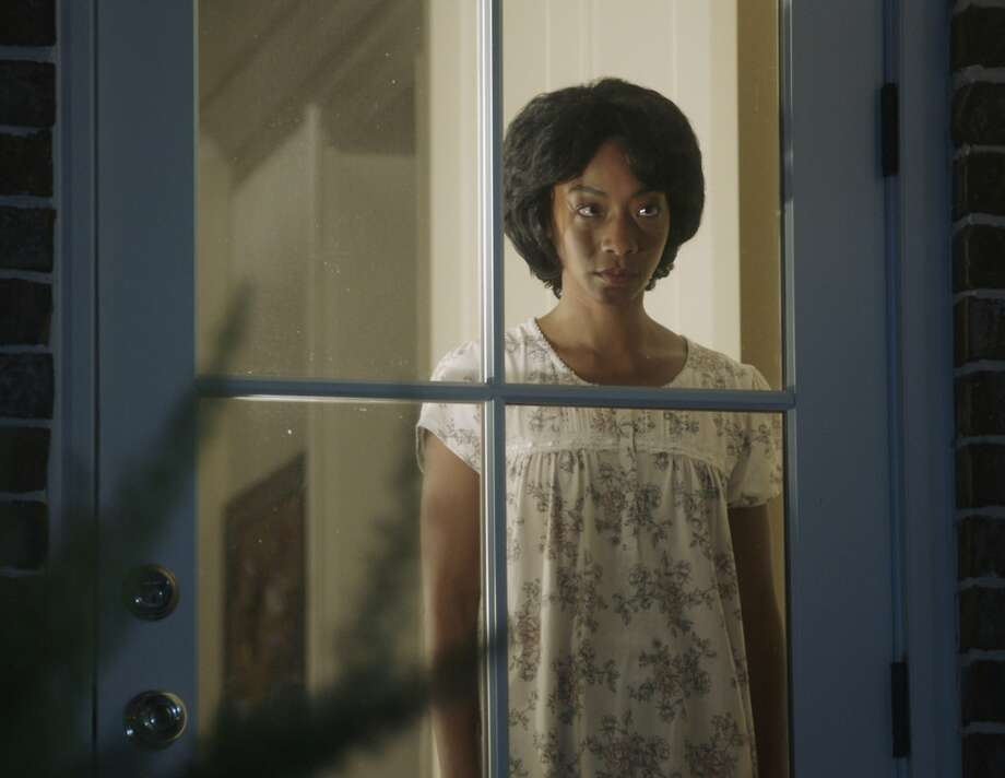 """Betty Gabriel's eyes signal there is something going on beneath the surface of her character in """"Get Out."""" Photo: Associated Press"""