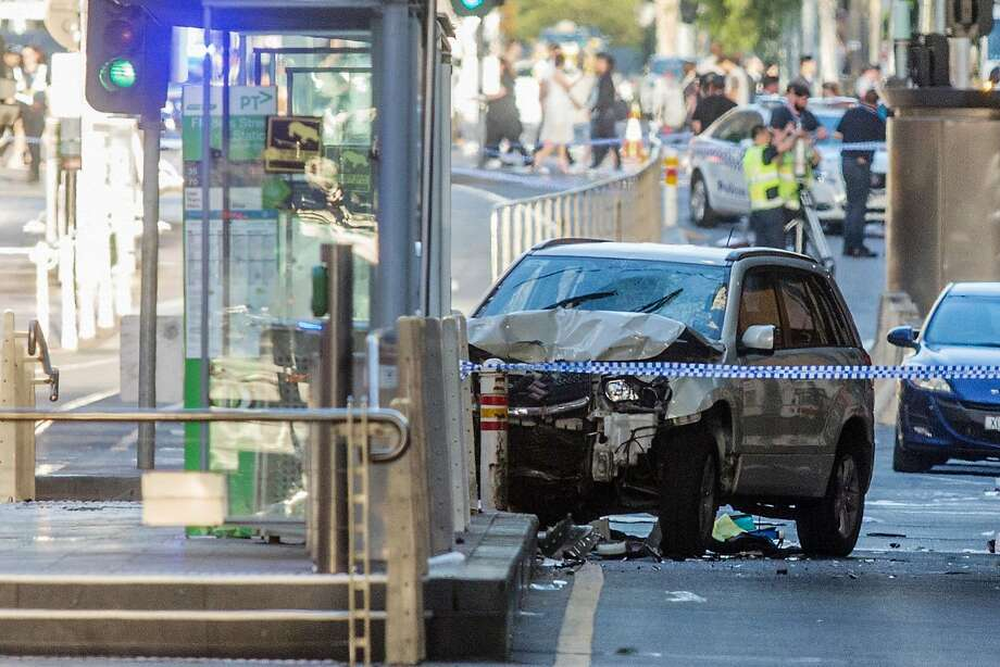 The driver of this SUV injured 19 people in Melbourne before crashing into a traffic barrier. Australian officials described him as mentally ill and the attack as a deliberate act of evil. Photo: ASANKA BRENDON RATNAYAKE, NYT