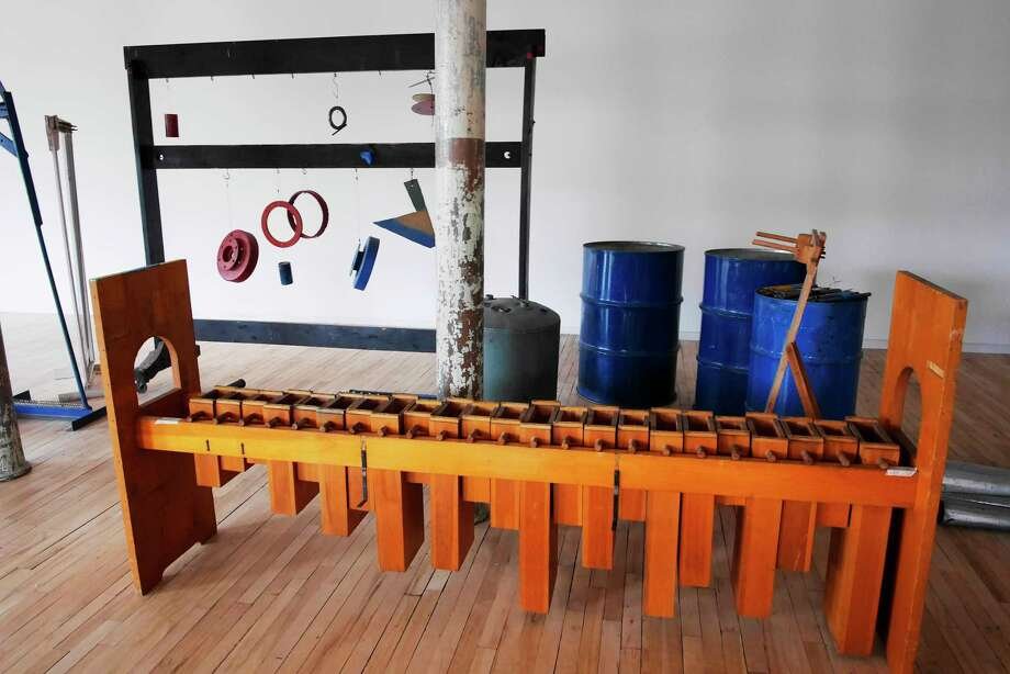 Musical instruments created by the late Gunnar Schonbeck, a Bennington College music professor, are on display in the newly renovated building 6 at Mass MOCA. / 20040119A