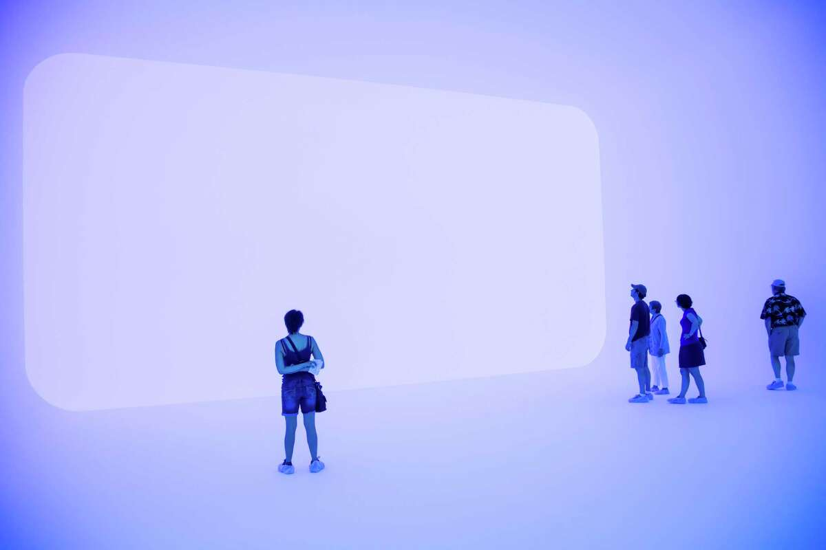 Patrons check out one of James Turrell's light-centered environments at the Massachusetts Museum of Contemporary Art in North Adams, Mass. The staff there voted to unionize on Wednesday.