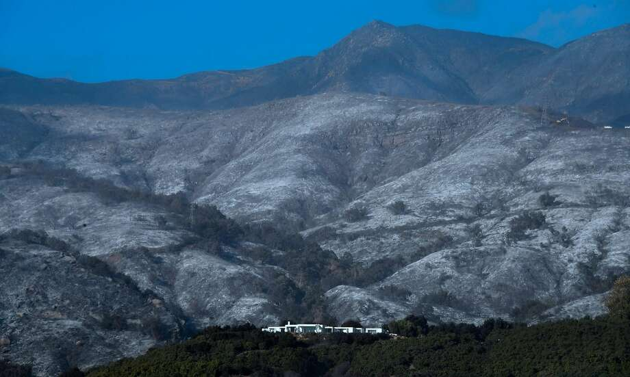 A house remains standing in front of an ash-filled hillside from recent fires in Montecito, Santa Barbara County, amid concerns the return of winds may spark the Thomas Fire again which authorities said was 60 percent contained. Photo: FREDERIC J. BROWN, AFP/Getty Images