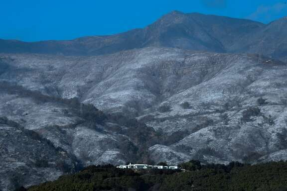 A house remains standing in front of an ash-filled hillside from recent fires in Montecito, California on December 20, 2017, amid concerns the return of winds may spark the Thomas Fire again which authorities said was 60 percent contained. The Thomas Fire northwest of Los Angeles is California's second-largest wildfire on record. / AFP PHOTO / FREDERIC J. BROWNFREDERIC J. BROWN/AFP/Getty Images