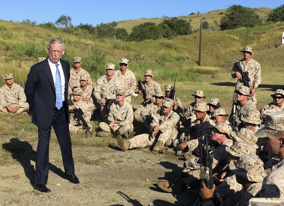 Defense Secretary Jim Mattis talks to U.S. Marine Corps troops at a rifle range at the Guantanamo Bay, Cuba. Photo: Robert Burns, Associated Press