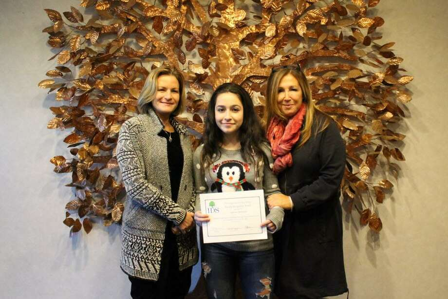 Eighth-grader Sabrina Iannucci of Middletown, a student at The Independent Day School in Middlefield, recently earned a faculty recognition award for the first trimester of the 2017-18 academic year. Students are chosen for their outstanding citizenship, cooperation with peers and adults and service to school. Iannucci, center, is shown with her parents Robin Diamonte, left, and Lori Iannucci. Photo: Courtesy Independent Day School