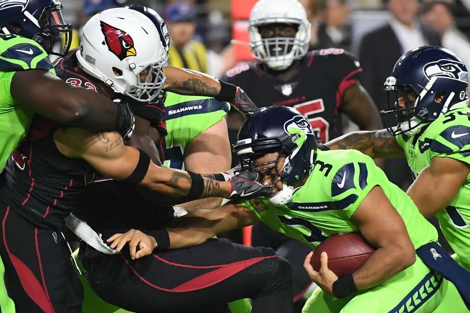 Quarterback Russell Wilson #3 of the Seattle Seahawks carries the football as free safety Tyrann Mathieu #32 of the Arizona Cardinals grabs his face mask in the first half at University of Phoenix Stadium on November 9, 2017 in Glendale, Arizona.  (Photo by Norm Hall/Getty Images) Photo: Norm Hall/Getty Images