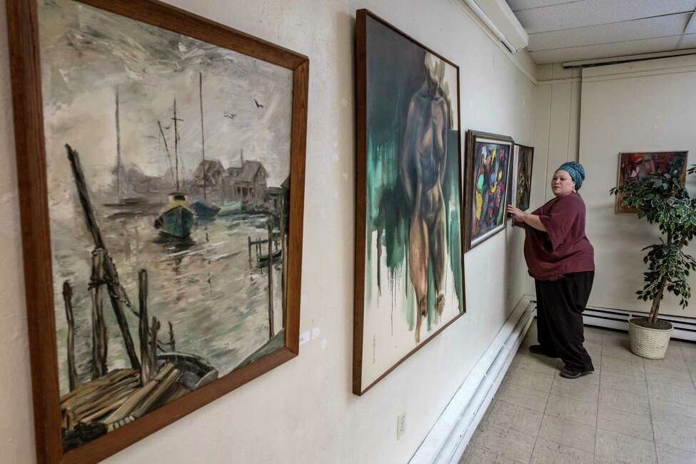 Rachel Conn, executive director, works on a display of artwork at the Hamilton Hill Arts Center on Monday, Dec 11, 2017, in Schenectady, N.Y. (Skip Dickstein/ Times Union)