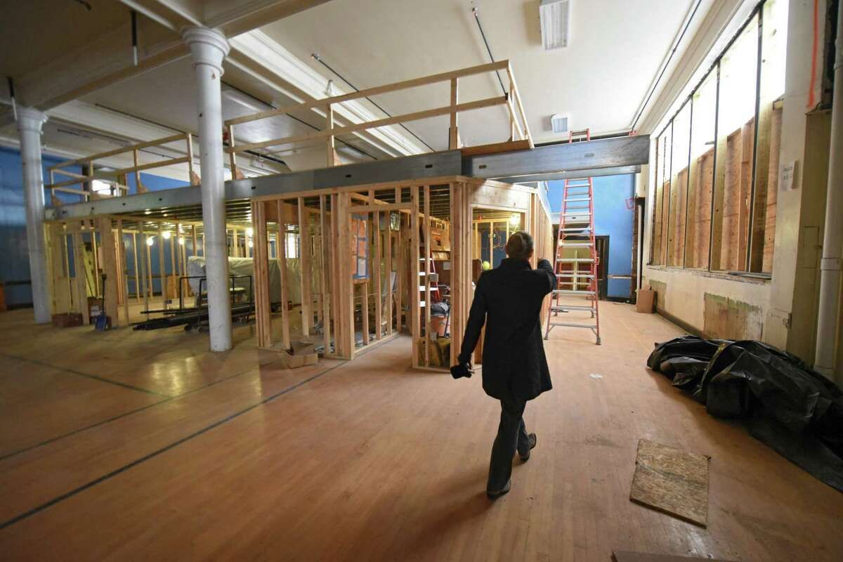 Jennica Huff, project manager with Boston-based Community Builders Inc., gives a guided tour of the work being done to convert a former school into Hillside ViewApartments and a maker space on Friday, Dec. 8, 2017 in Schenectady, N.Y. This is the maker space area. (Lori Van Buren / Times Union)