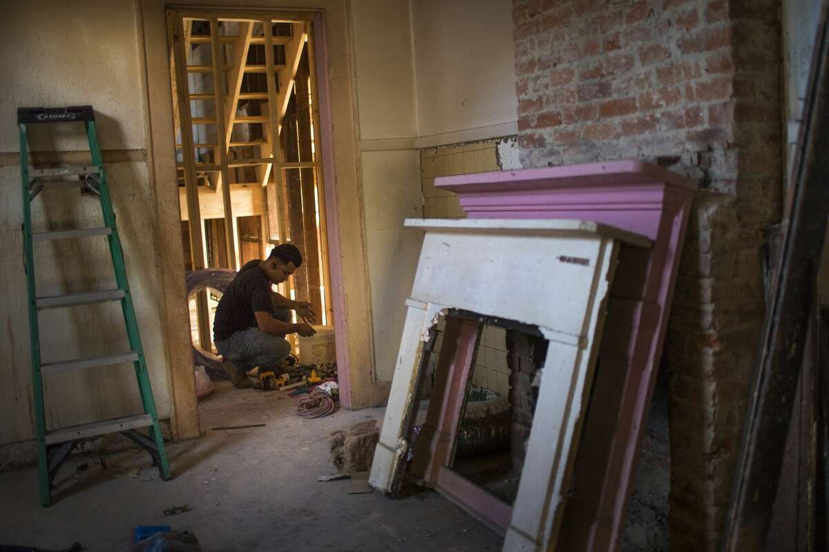William Gilberto Landaverde, 22, works on putting together the new pipes of a building being renovated in New Orleans.